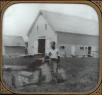 Good Will boy feeding chickens, Fairfield, ca. 1925