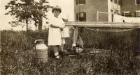 Ellie Macomber feeding chickens, Fairfield, ca. 1925