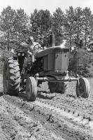Mark Thompson on tractor, Fairfield, ca. 1955