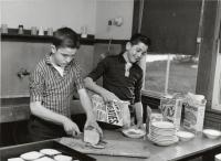 Good Will boys making breakfast, Fairfield, ca. 1950