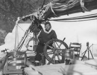 Miriam MacMillan at the wheel, Northwest Greenland, 1948