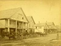 "Main Street through ""the village,"" Strong, ca. 1890"