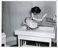 Cottage baby with student nurse, Farmington, ca. 1947