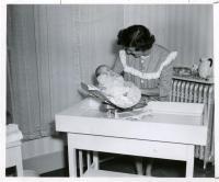Cottage baby with student nurse, Farmington, ca. 1947