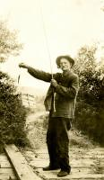 "Ab Robbins shows-off his ""Catch of the Day"", Strong, ca. 1922"