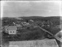 C. V. Starbird Store and mill yard, Strong, ca. 1910