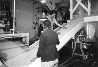 Inspecting whole kernel corn, Fryeburg, ca. 1940