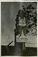 Farmington State Normal School students climbing a billboard, ca. 1917