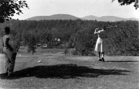 Woman golfing, Bethel, ca. 1950