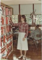 Gilman School's Janet Tarbuck in library, Waterville, 1983