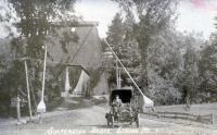 L. Roy Lewis drives across the suspension bridge, Strong, ca. 1912
