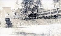Light cargo truck on suspension bridge, Strong, ca. 1914