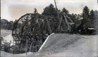Steam crane works on skeleton of new iron bridge, Strong, ca. 1922