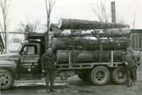 Log load arrives at Starbird Lumber Co., Strong, ca. 1955