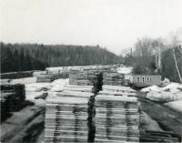 Stacked long lumber, Starbird Lumber Co., Strong, ca. 1957