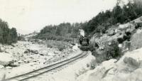 S.R.R.L. short freight train follows the brook, ca. 1920