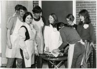Home Economics students grilling, University of Maine at Farmington, ca. 1971