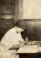 Keeping records, eye clinic, c. 1925