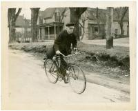 Henry F. Smith age 72, on bicycle, Westbrook, 1940