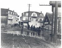 A high tide at East Boothbay's tide mill and bridge ca. 1910