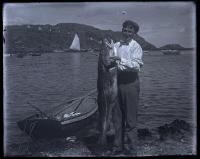 Fisherman Ernest L. Smith with codfish, Monhegan, 1910