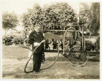 Woodbury K. Dana with cotton harvester, Westbrook, ca. 1918