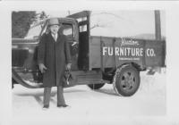 Denis E. Hudon and his furniture delivery truck, Ridlonville, ca. 1949
