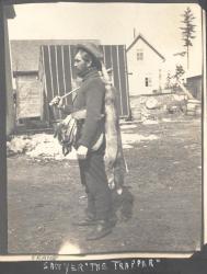 Bob Sawyer with pelts, Norcross, ca. 1910