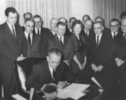 President Lyndon B. Johnson signs the Clean Air Act, December 17, 1963