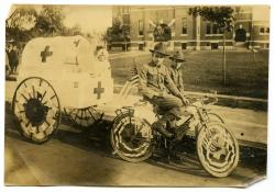 Red Cross cart in bicycle parade, Biddeford, 1917