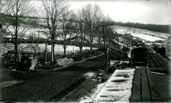 Brackley's conveyor over Depot Street, Strong, ca. 1924