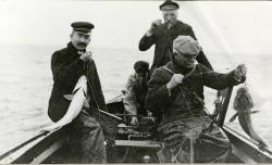 Four men line fishing from a dory, Swan's Island, ca. 1910