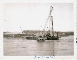 Cranes working on bridge construction, Lubec, 1961