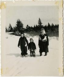 Three skaters at the Quarry Pond, Swans Island, 1949