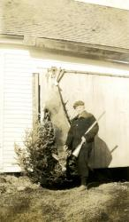 Emma Allen displays her spikehorn buck, Strong, ca. 1936