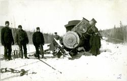 S.R.R.L. Engine# 7 being righted onto rails, Bigelow, ca. 1916
