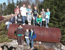 Swan's Island 3-5 grade class on an old quarry boiler