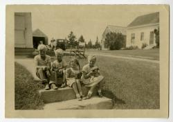 Kids on the steps of Clevie Trask's home, Swan's Island, ca. 1950
