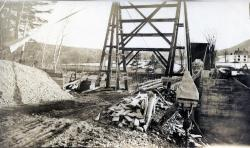 Preparing to replace suspension bridge, Strong, ca. 1921
