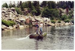 Trying out the pump, Swan's Island, 2003