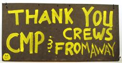 Sign thanking utility crews, 1998