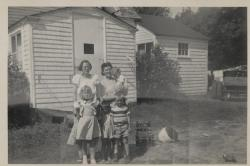 Mary L. Savage, Ernestine Savage and Savage Children in front of the Old Ell 1950