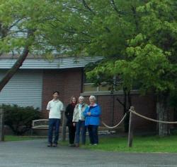 SBHS volunteers Carolyn McKeon, Ellen Wells, and Donna Plummer with teacher Jason Bigonia in front of the South Bristol School