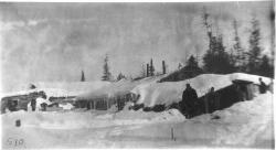 Lumber camp in winter