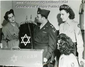 Captain Gordon shows 'Flying Torah,' Bangor, 1945