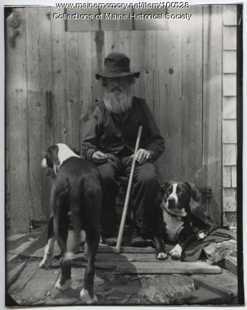 Seated man with dogs, ca. 1900
