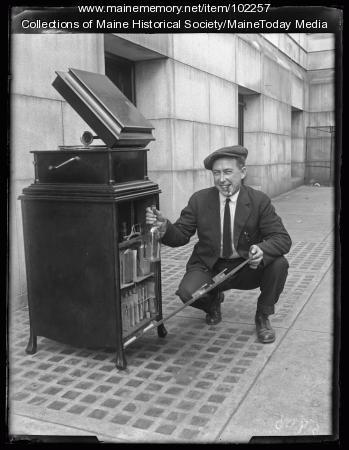 Man with cigar revealing secret liquor stash, Portland, ca. 1922