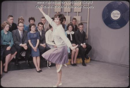 A cast regular student guest performs on the set of The Dave Astor Show, Portland, 1962