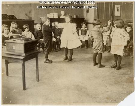 Primary students dancing, North School, ca. 1900