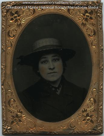 Young woman in straw hat, ca. 1900